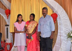 OVERALL TOPPER WITH HER PARENTS